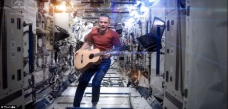 Commander Chris Hadfield records a cover version of David Bowie's 1969 Space Oddity as a farewell message to Twitter fans. Hadfield has been aboard the International Space Station since December and is due to return to Earth on Tuesday. He has posted stunning photos of space during his five-month stint, and recorded videos showing how astronauts brush their teeth and how to throw up in space ©DailyMail
