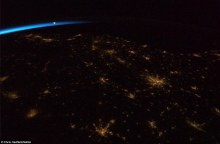 One of Canadian astronaut Chris Hadfield's latest pictures from the International Space Station shows a darkened south-eastern United States just before dawn, with the moon rising above ©DailyMail