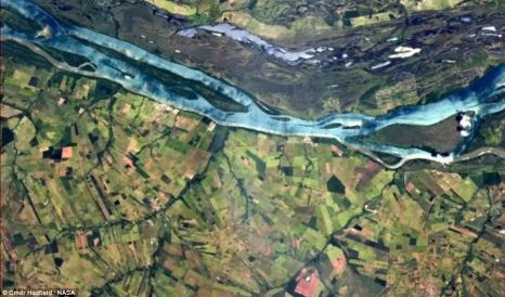 Commander Hadfield posted this shot of a vivid blue river snaking through Brazilian farmland on his Twitter page ©DailyMail