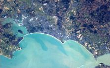 Most of Commander Hadfield's pictures of the UK were taken at night, but this one shows the beautiful blue sea surrounding the coast of Bournemouth in Hampshire ©DailyMail