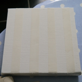 1. Primed canvas with stripes of filler