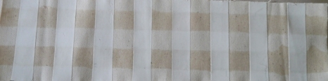 19. Raw canvas with vertical filler stripes over-painted with horizontal varnish stripes. Natural light