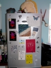 My fridge front. The main thing on here is a piece of felt I created at the start of the course. Far too literal and twee - but I love the colour combos. Postcard quotes from MoMA in NYC, LucianFreud and Naomi Ryder's work. And a giant lemon slice tea cosy I made 20 yrs ago.