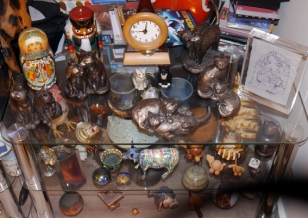 My collection of bits of art! Lots of wood, ceramic, cats, blue things...