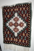 I bought this rug in Tunisia - it's motifs are taken from the Mosque in Kairouin.