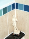 I love this little sculpture my parents bought me back from Italy. I love the idea of Michael looking over me while I am in the bath! I chose the tile and paint colours in the bathroom... teals and golds.