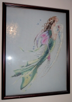 Cross stitch kit of a mermaid. Many intricate pearls in in this and I love the captured movement.