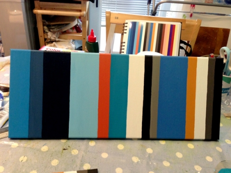 Finished painting with the original diary in the background.
